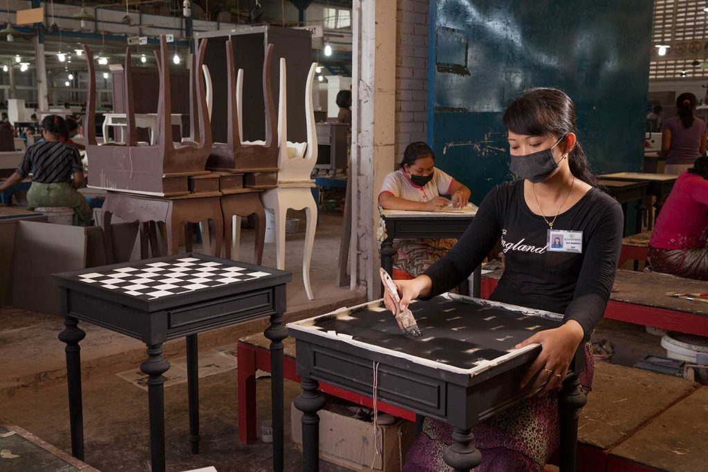 A female painter working for Pijar Sukma, a furniture supplier in Jepara
